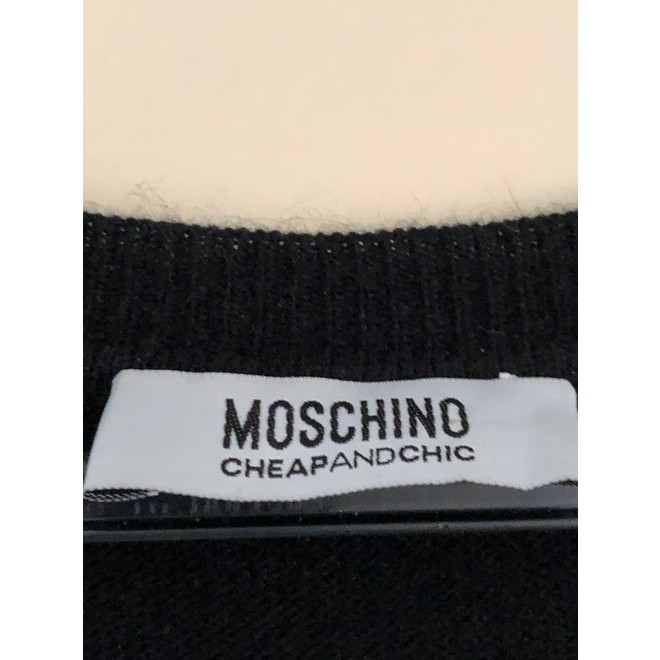 tweedehands Moschino Mouwloze top